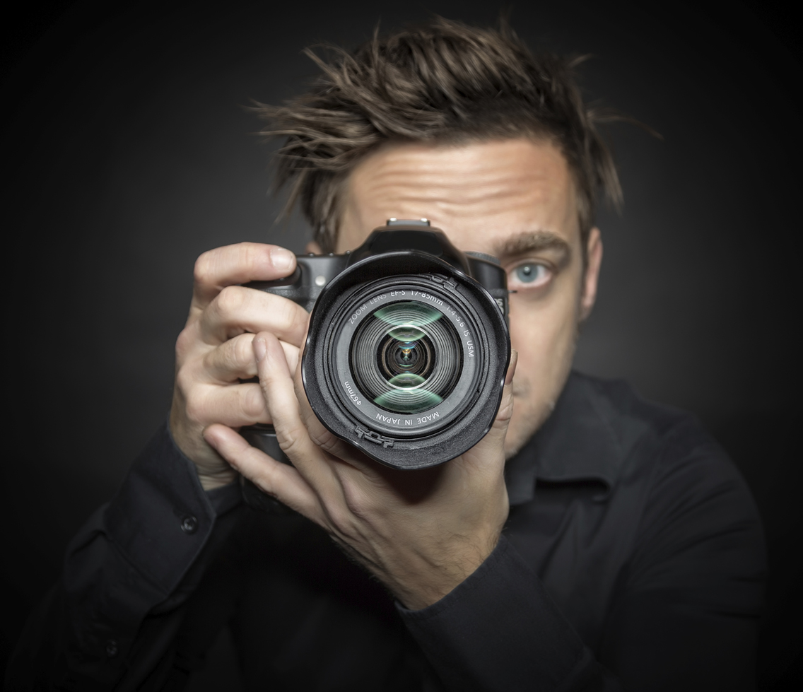 Photographer on a dark background